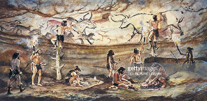 Scene depicting Cro Magnon painters of Lascaux Cave