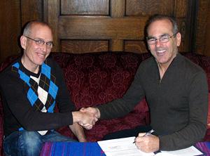 Jay Peregrine & Gaetan Charland signing the UF - UAI social trademark license