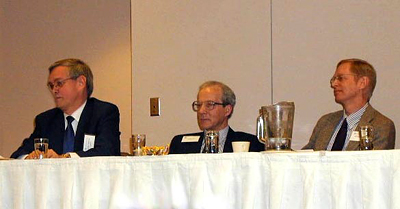 Seppo Kanerva, Ralph Zehr, and Jeffrey Wattles in a panel discussion on outreach.